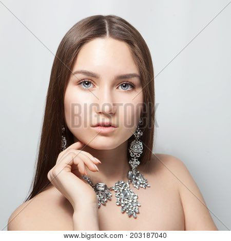 Portrait Of Beautiful Young Blonde Woman In Ear-rings