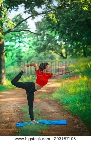 yoga; woman; female; girl; outdoors; sport; fitness; healthy lifestyle; Beautiful; nature; slim; beautiful girl; beautiful woman; Stretching; Mental Health; Caucasian; Activity; Body Care; Sports; Beauty And Health; yoga pose; Pilates; yoga practice; woma