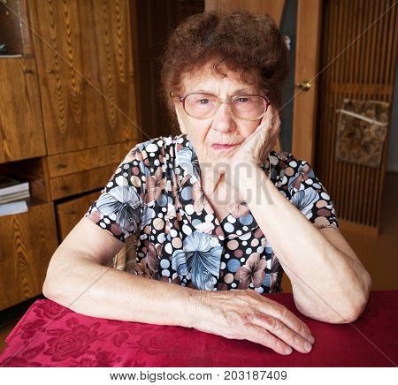 Elderly female at home. Old woman.