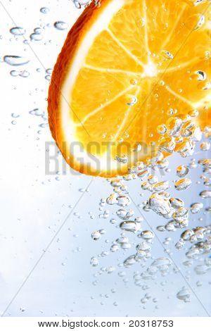 slice of orange in bubbly drink