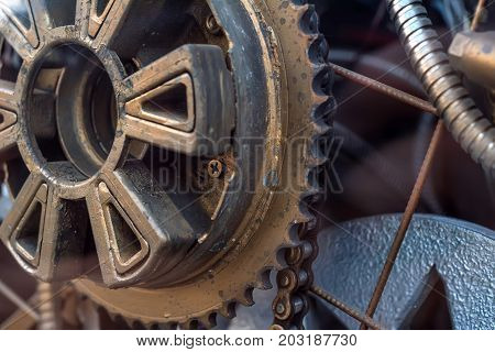 Close up metal gear and chain part of mechanism