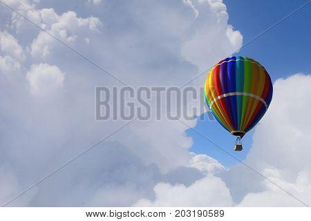 Aerostat floating in day sky. Mixed media