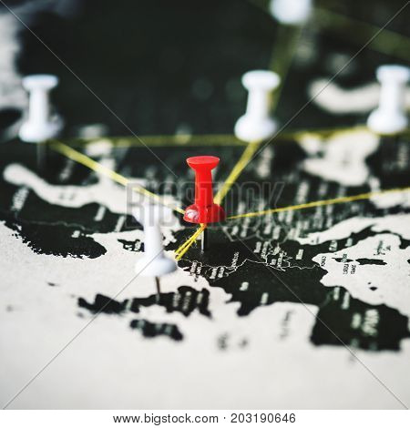 Closeup of pins on world map journey travel