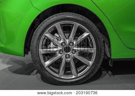 Close Up Rear Wheel Right Of A Green Sports Car, Rear Wheel Drive