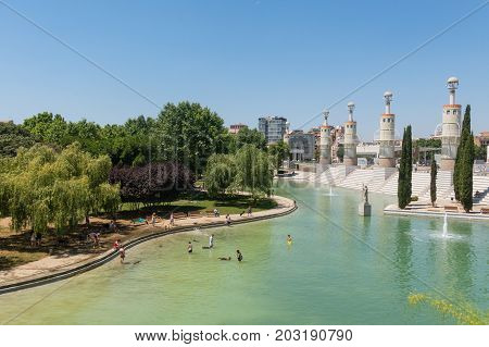 People Bathing In The Pond Of Industrial Park In Sants District, Barcelona, Spain