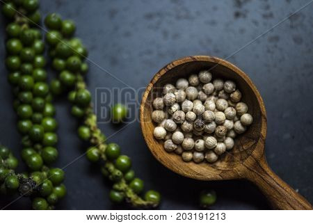 Aerial view of peppercorns on black background