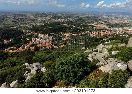 Aerial view of Sintra, Portugal from the top of hill in Sintra Mountains.. Since 1995, the cultural landscape of Sintra is listed as UNESCO World Heritage
