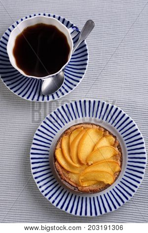 Peach tart and black coffee