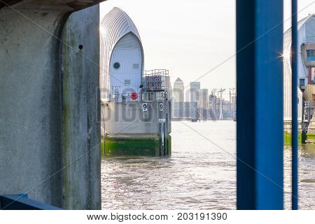 Thames Barrier With Canary Wharf  In London