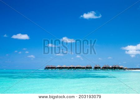 beach with water bungalows at Maldives