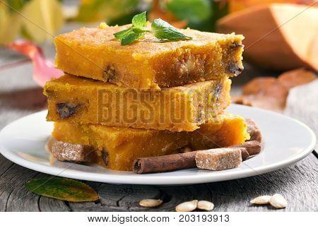 Sliced pumpkin pie with nuts healthy vegetarian dessert