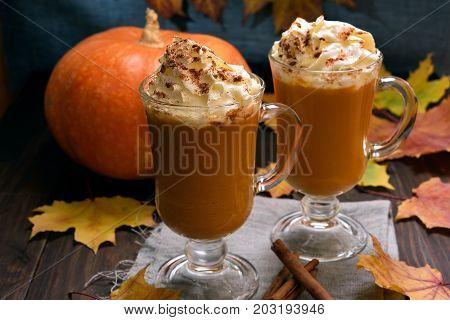Pumpkin latte with whipped cream autumn seasonal beverage