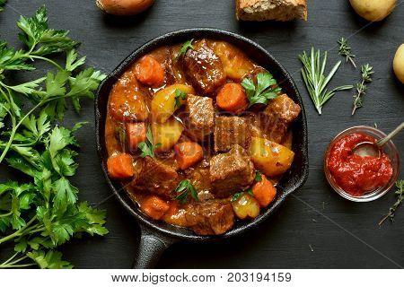 Stewed beef and vegetables in frying pan top view