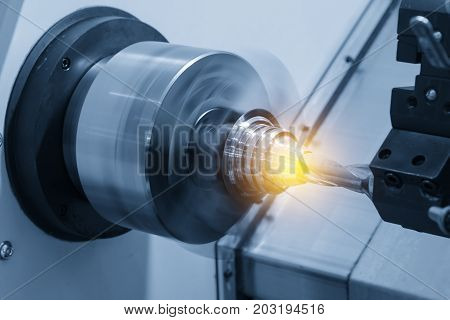 CNC lathe machine or Turning machine drilling the steel cone shape rod .Hi technology manufacturing process.