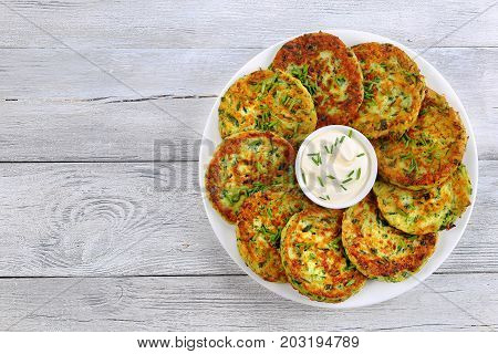 Tasty Zucchini Fritters With Sour Cream