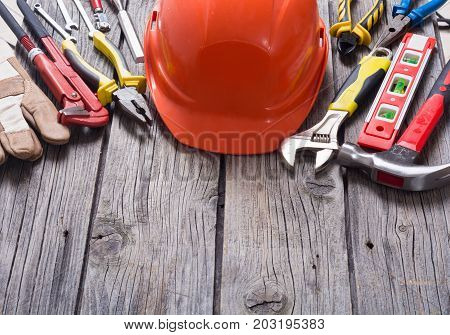 Set of tools on wooden background . with space for text