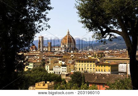 View on the Cathedral di Santa Maria del Fiore (Duomo di Firenze) between two trees Florence Italy