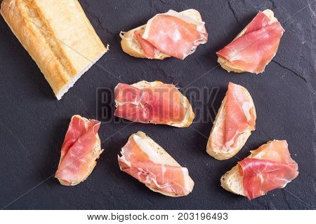 Sandwich with jamon om old stone rustic background