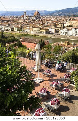 outdoor restaurant with a view on on the Florence Arno river and Cathedral di Santa Maria del Fiore (Duomo di Firenze) 2017-08-20 Florence Italy