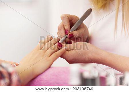 Cuticle Remover. Manisure Treatment. Close Up.
