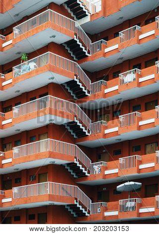 Puerto de la Cruz Tenerife Canary Islands - May 28 2017: Texture of multistorey apartment house wall with balconies and windows in Puerto de la Cruz Tenerife Canary islands Spain