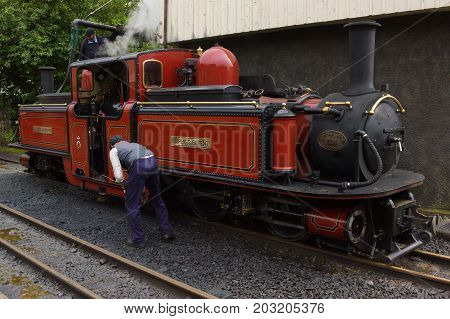 Blaenau Ffestiniog Wales UK - September 4 2017: The narrow gauge steam locomotive David Lloyd George of the Ffestiniog Railway Company having maintenance performed at a watering stop