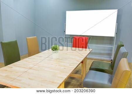 mock up white board in meeting room with conference table