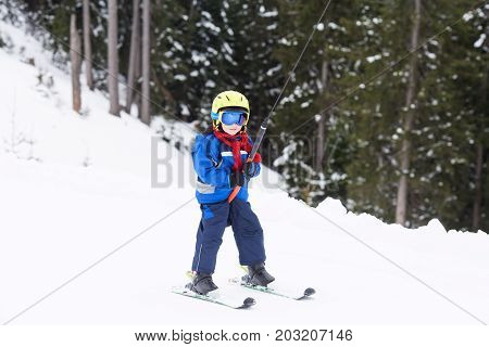 Young Child, Going Up A Hill With A Surface Lift, Standing On The Ground