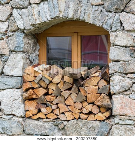 Firewood Logpile Stacked In A Window