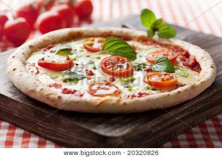 fresh italian pizza, with tomato, mozzarella and green pepper