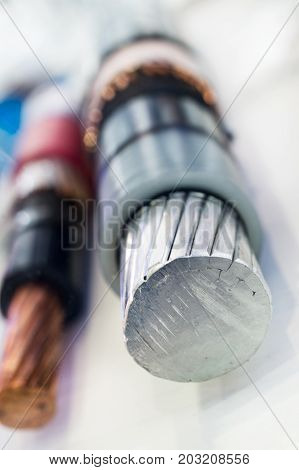 Cross section of high-voltage cable. Thick aluminum wires surrounded by a layer of polymer insulation.