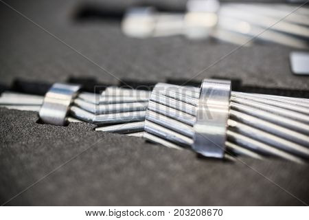 Cross section of high-voltage cable. A dense round bundle of aluminum wires.