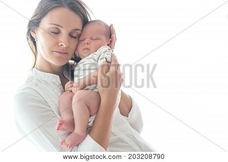 Young Mother, Holding Her Newborn Baby Boy