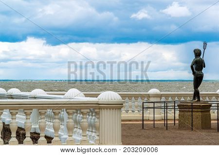 Peterhof, Russia - June 03. 2017. The sculpture of Neptune on the embankment of the Gulf of Finland