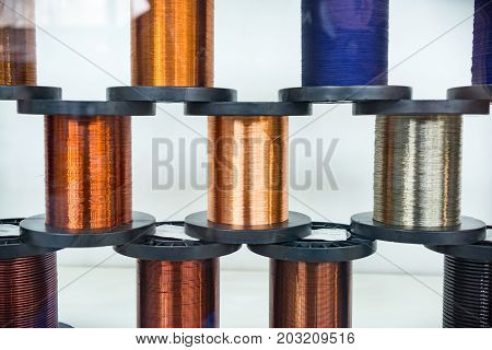 A lot of coils with copper, aluminum and brass wire. Abstract industrial background.