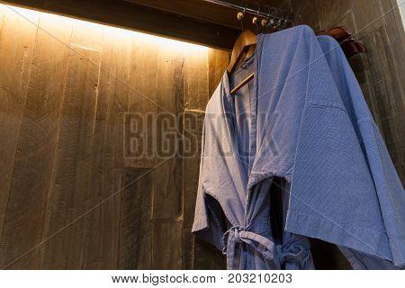 Close-up Blue Twin Bathrobe In Wooden Wardrobe Of Luxury Hotel