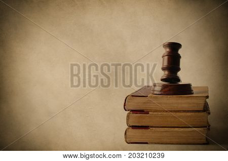 Wooden Gavel On Top Of Old Books