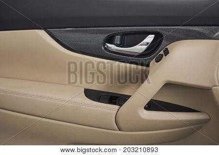 Close up image of a car door opener.