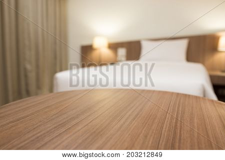 empty wooden table in a hotel room