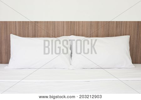 White pillows on a comfort bed in bed room