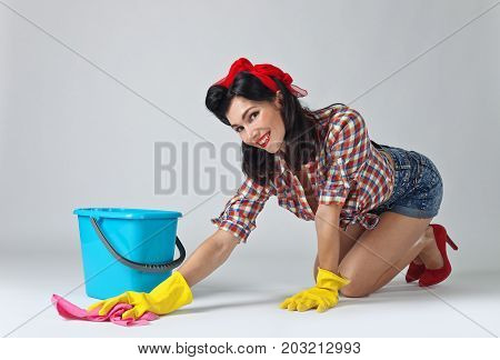 Beautiful Woman In Rubber Gloves .