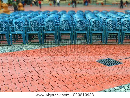 Stack of green plastic chair in the city square