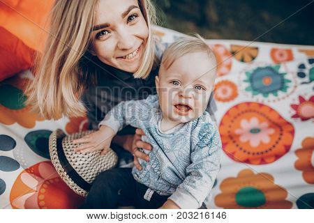 Stylish Hipster Mother Relaxing In Hammock With Son In Sunny Summer Park. Blonde Mom With Cute Kid P