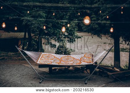 Colorful Stylish Travel Hammock Underl Lamp Lights In Summer Forest. Resting, Camping And Relaxing O