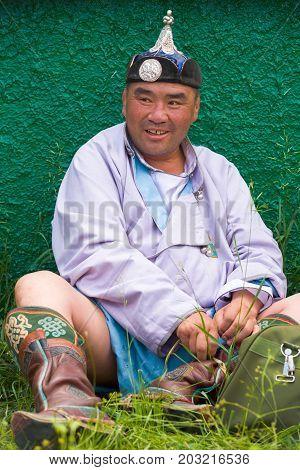 Naadam Festival Heavyweight Wrestler Sitting Grass