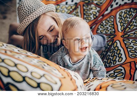 Happy Hipster Mother Playing With Her Cute Little Son On Hammock In Summer Sunny Park. Stylish Mom W