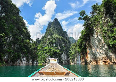 Huge Limestone Cliffs Rising Out Of Open Lake At Khao Sok National Park, Ratchaprapha Dam In Surat T