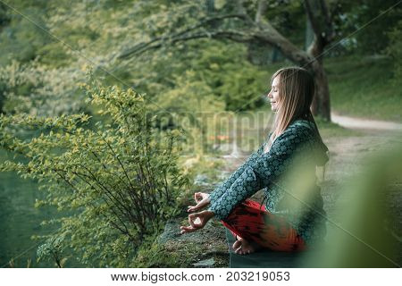 Meditating By The Lake, One Woman Only, Toned Image, Outdoors