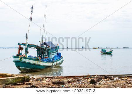 SIHANOUKVILLE CAMBODIA - 7/20/2015: Two fishing boats along the coast of Cambodia.