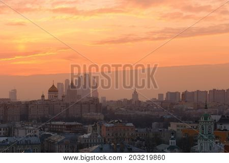 Christ Savior Cathedral and skyscrapers in fog at morning in Moscow